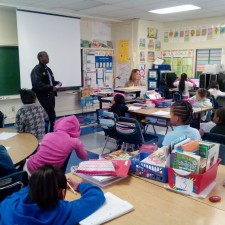 James Knox speaks to students at Longfellow Elementary School on during the school's career day on Nov. 18